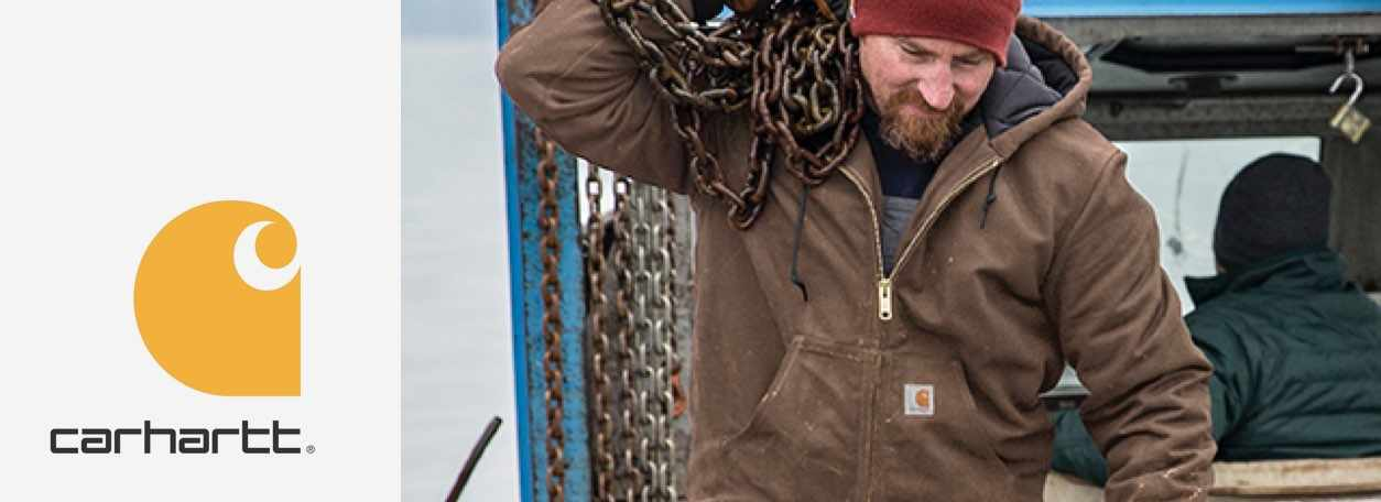 A man carries chains while wearing a Carhartt jacket.